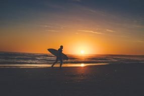 Surfer on the beach photo