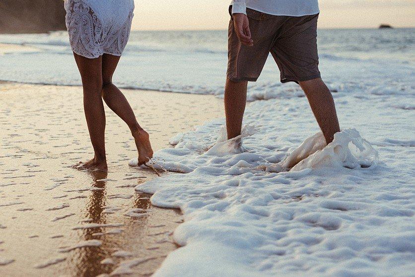 Couple walking on beach photo